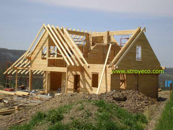Wooden cottage from glued beams. Photo 1